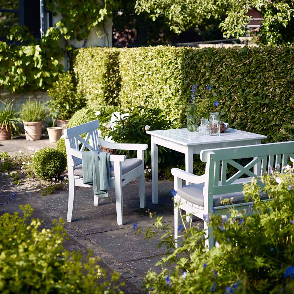 for small gardens: drachmann sapelli wood dining set with optional seat cushions in color ash | note: sapelli wood no longer stocked in the U.S.; lead time 4-6 weeks