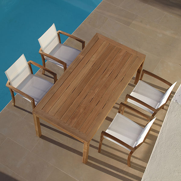 """four XQI armchairs around the XQI 71"""" dining table (sling: batyline, white)"""