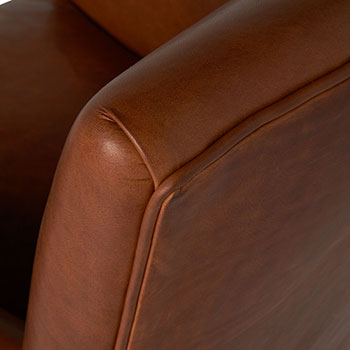 leather detail on valente chair shown in spur terracotta