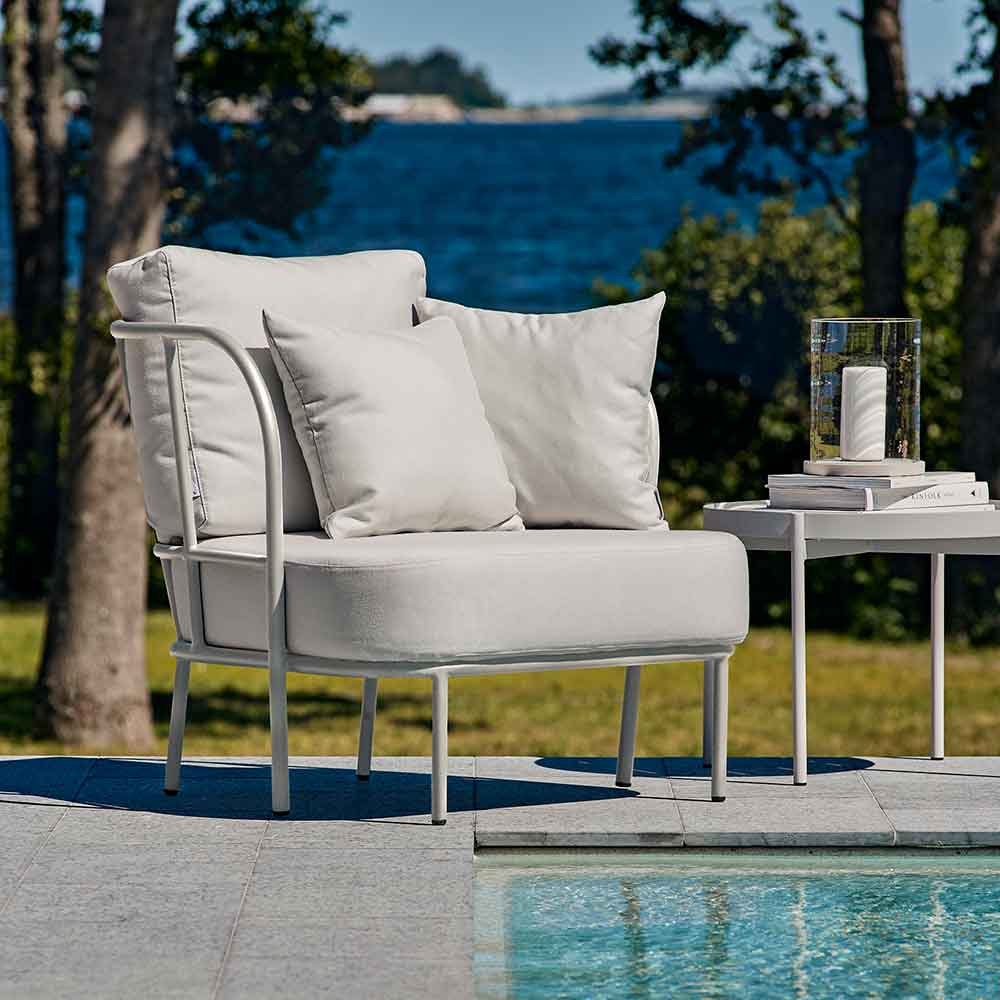 relaxing by the pool: salto lounge chair and lounge table with skargaarden's moja lantern