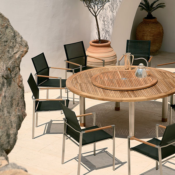 lazy susan with stainless steel accents used with barlow tyrie's equinox teak-stainless steel dining table