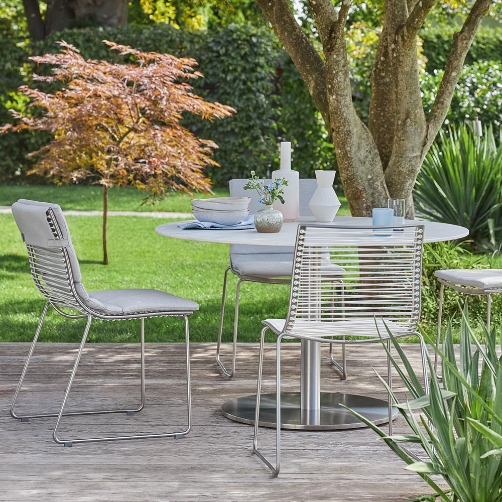 light as a breeze: a lightweight construction and airy design make the pan dining chair easy to move around