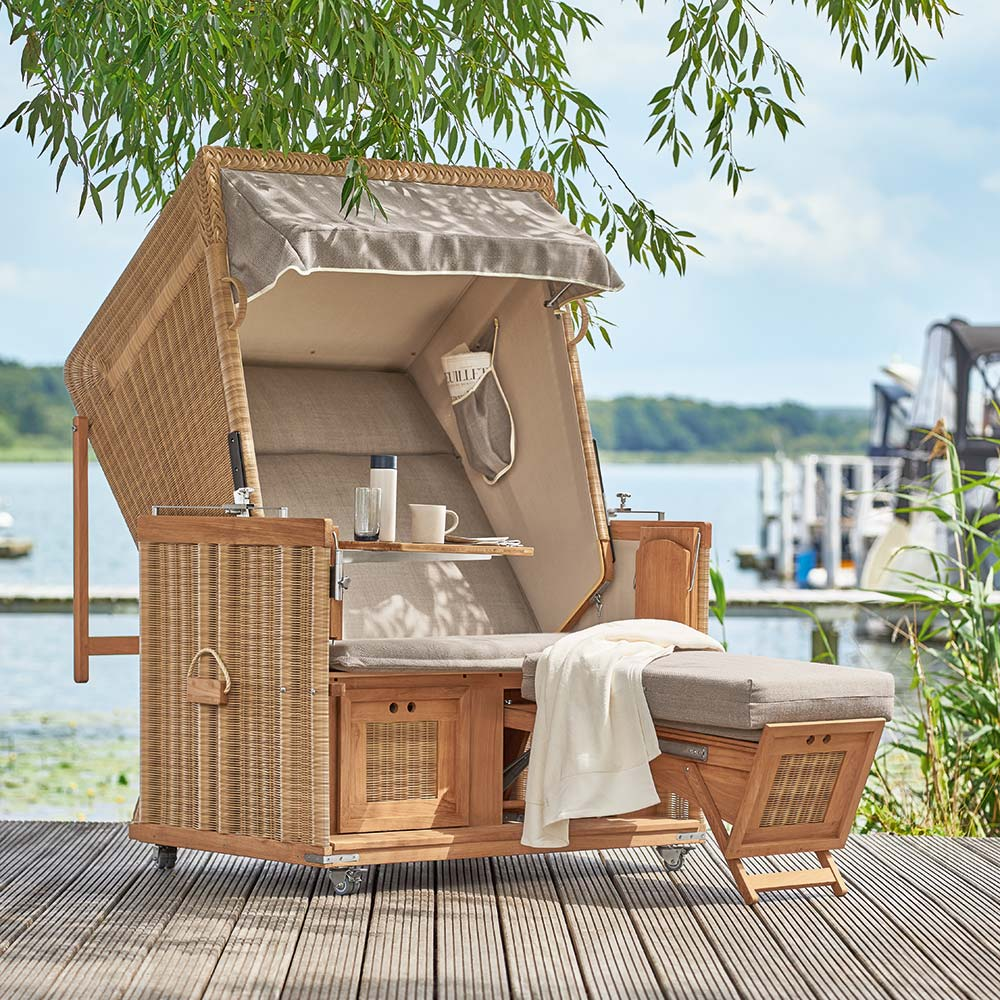 summery design: the hazel strandkorb beach chair is an idyllic place to spend a summer day by the sea