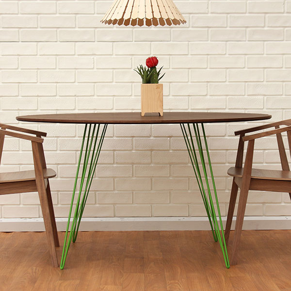 """sidney 54"""" oval dining table (walnut top) with green-coated steel legs"""