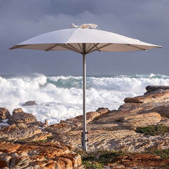 dramatic ambience: storm center pole umbrella tested by nature's fury around the cape of good hope, south africa