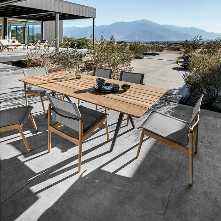 """six sway side chairs (meteor/ granite) with gloster split 67"""" teak tableimage provided courtesy of gloster furniture, inc."""