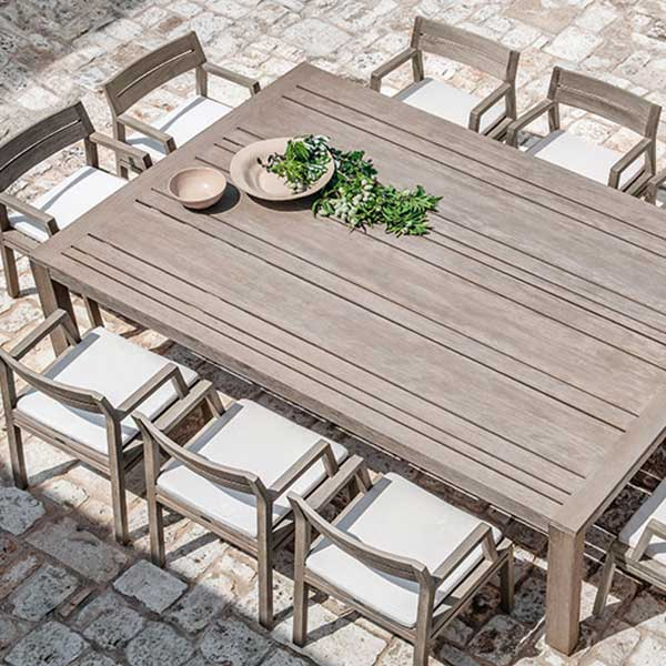 "dinner party for 10 on the patio: 95"" rectangular dining table with 10 dining armchairs (pickled teak/ nature white)"