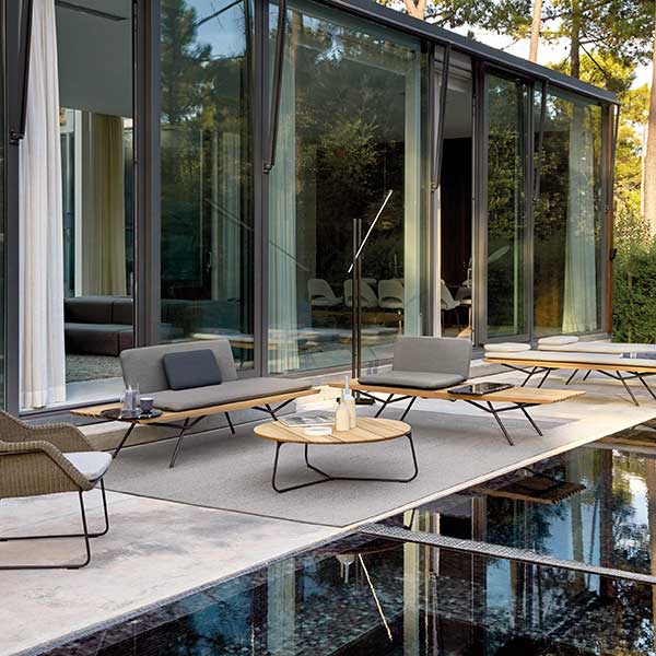 a full outdoor setting: sofa, one-seater, lounger, marble rectangular and marble round