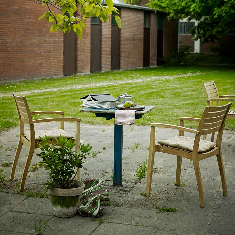 comfy quick seating solution: two ballare dining chairs in teak with optional seat cushions in ash
