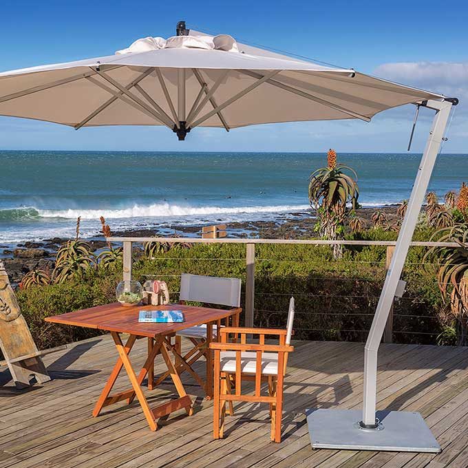 abundant shade: woodline's 10.5' picollo round cantilever umbrella an aesthetic design that's versatile and durable