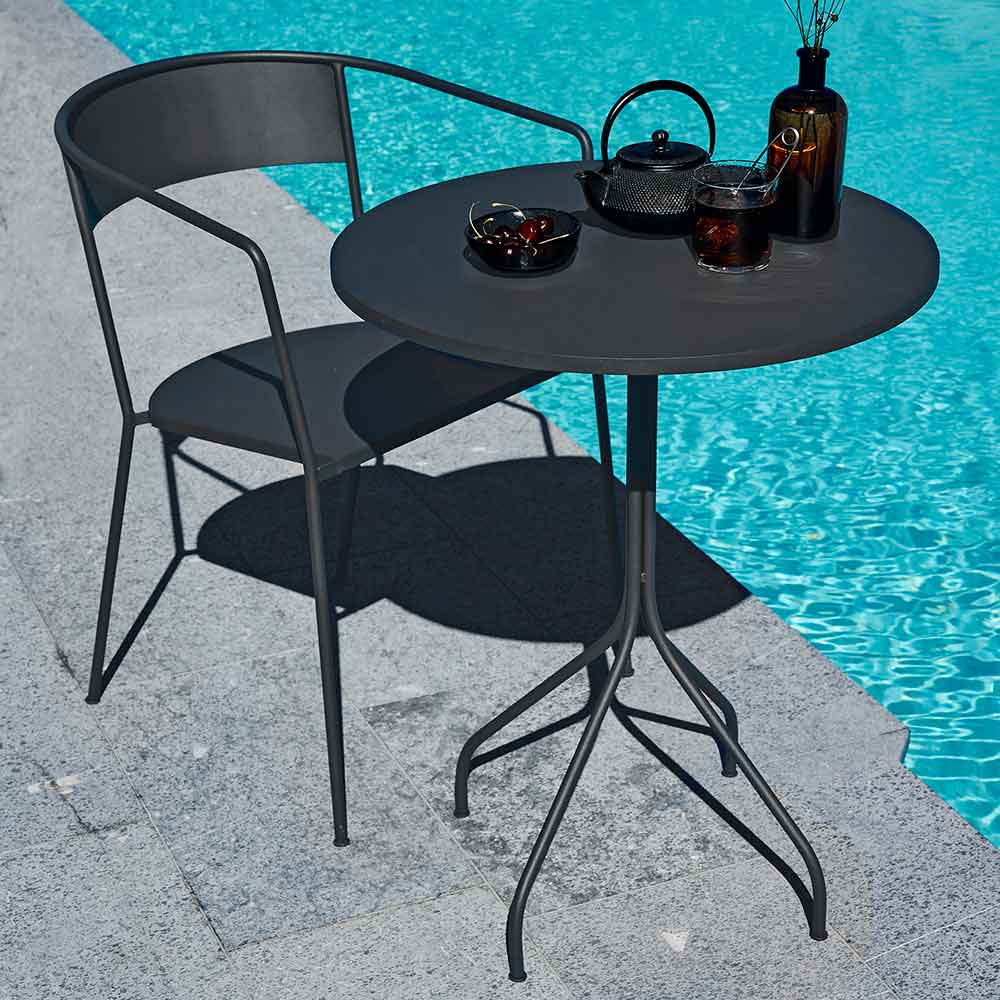 "table for one at the poolside: arholma dining armchair paired with 24"" arholma small table"