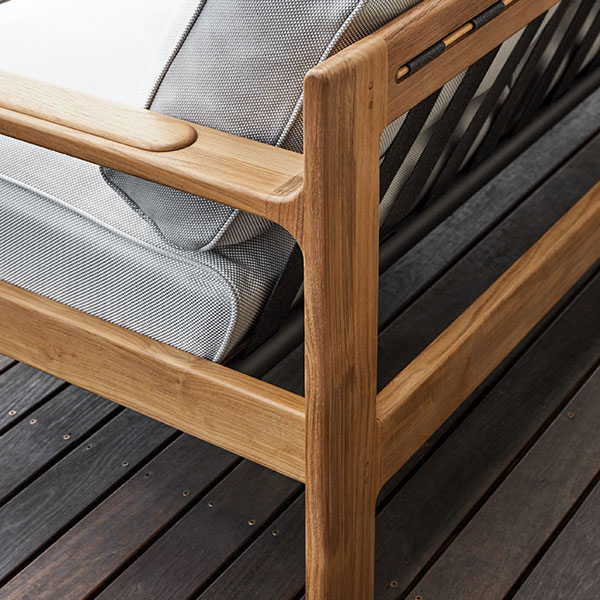 detail of natural teak construction on loop sofa frame