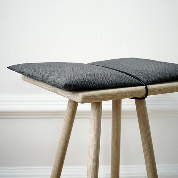 close-up: georg stool in oak with cushion (cushion included in price)