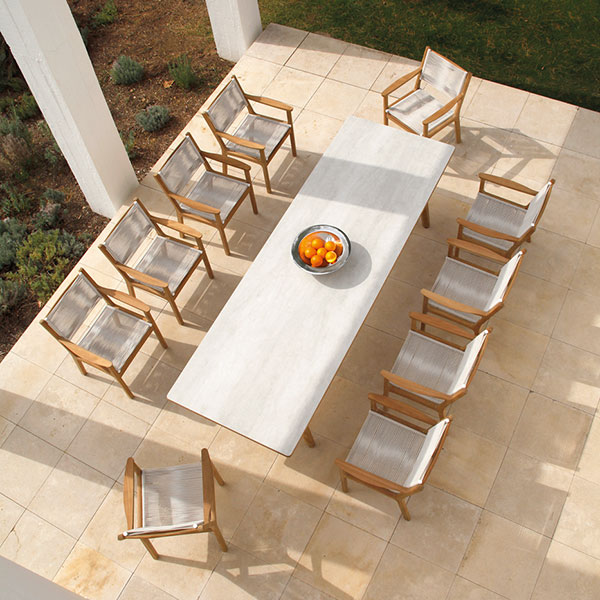 """patio party: ten armchairs (chalk) around the 118"""" teak dining table with ceramic top (frost)"""