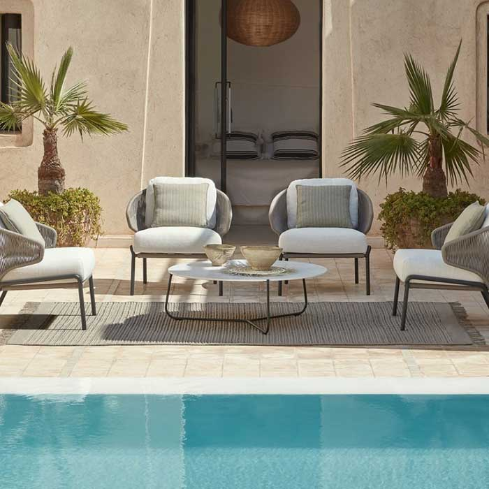 seating for four: four radius 1-seaters in lava frame with bronze rope (deco cushion included in price)