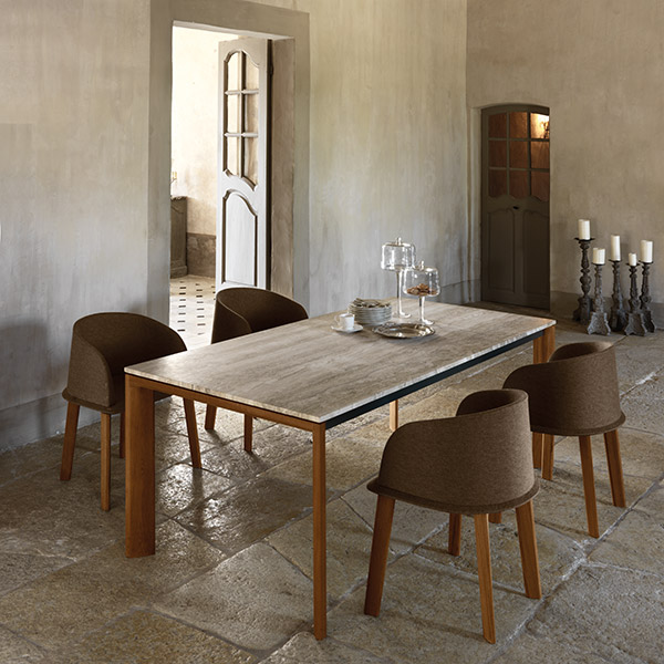 """indoor dining: four cleo tub chairs staged with 87"""" dining table with limestone top (frame teak 