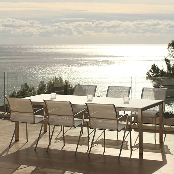 taboela dining table (frame: stainless steel; top: glass or ceramic) paired w/ six alura armchairs