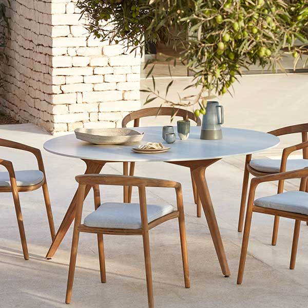 """table for five: 58"""" dining table (frame: teak, table top: marble white) surrounded by solid armchairs"""