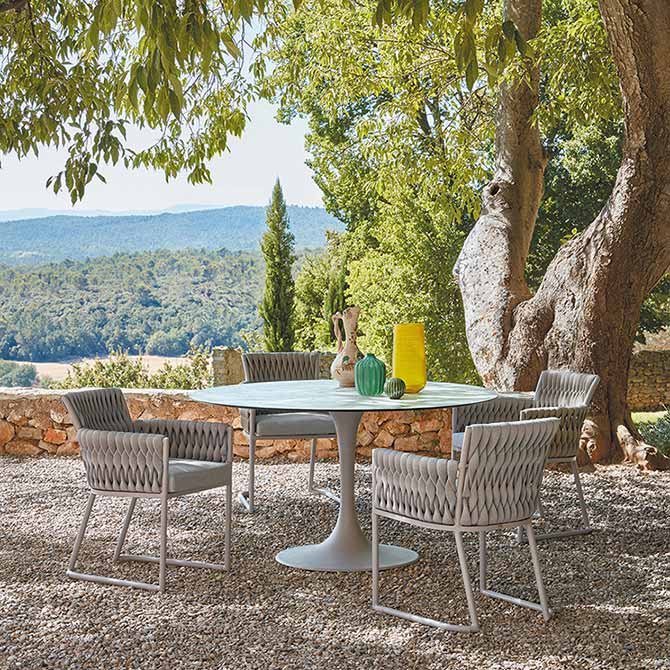dining in style: four basket dining chairs staged with sifas' korol round dining table