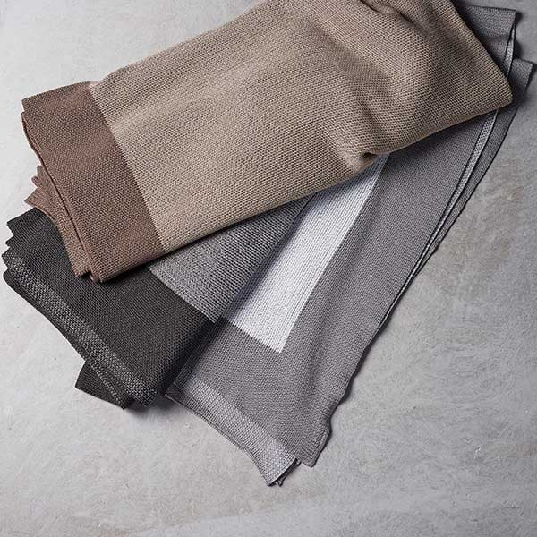 stock up on blankets: cane-line stay-warm plaids in two color variations, granite and dusty white (color latte has been discontinued)