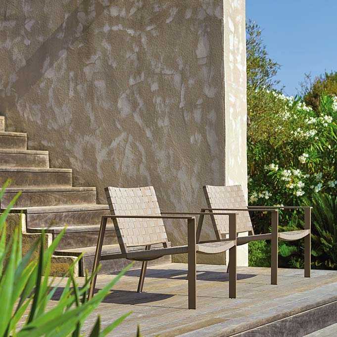 enjoying the view: two pheniks lounge chairs in moka aluminum and taupe textylene weave