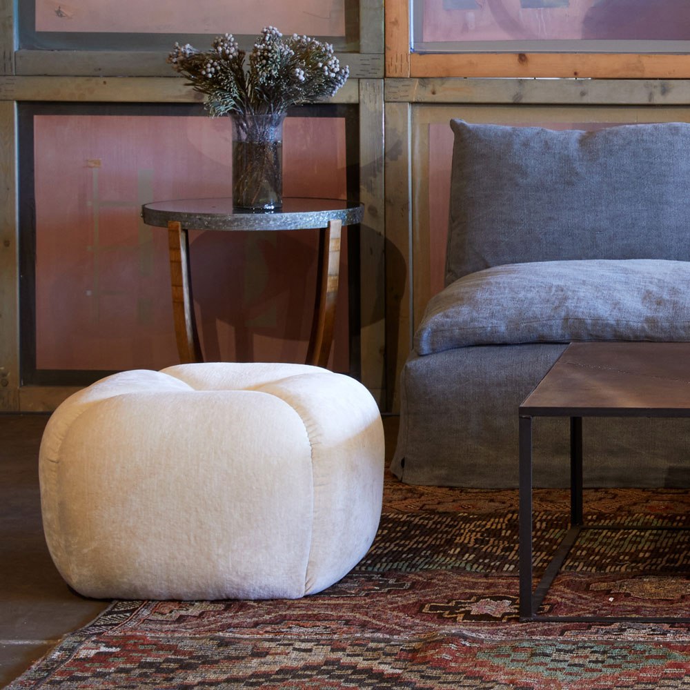 tonto ottoman accent in a living room setting (fabric: velluto stone)