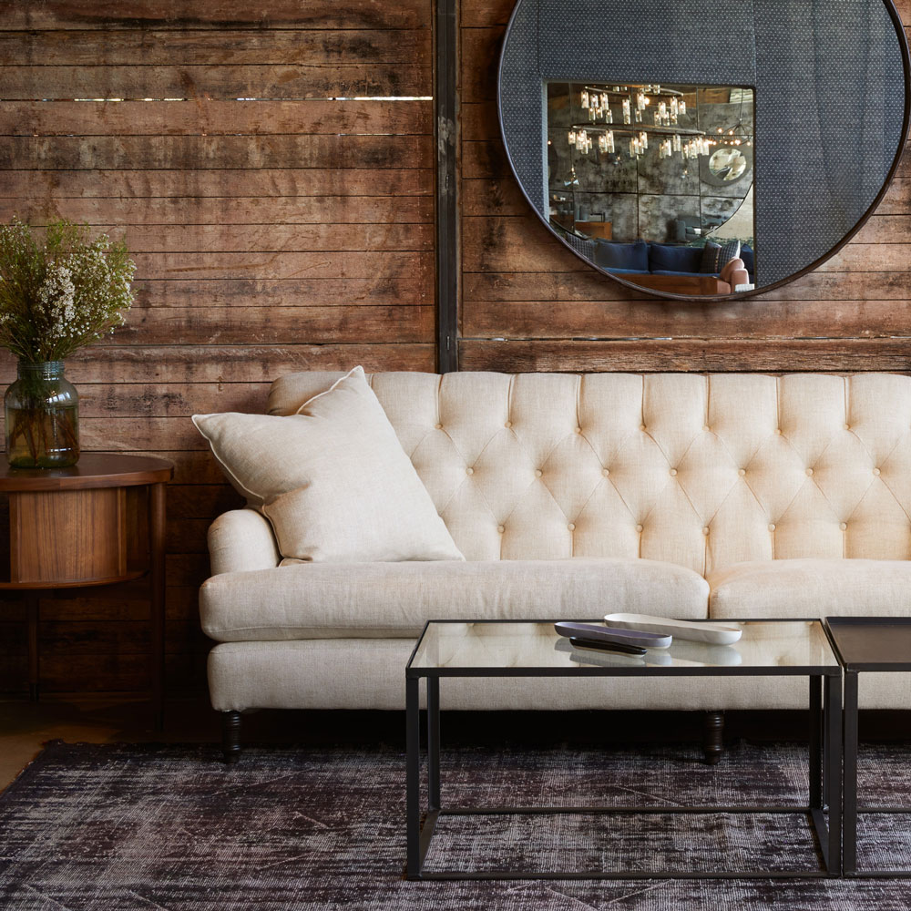 tailored henderson sofa in avery oatmeal set against gritty, natural textures