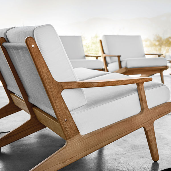 bay detail: cushions with welt and rounded teak framesimage provided courtesy of gloster furniture, inc.