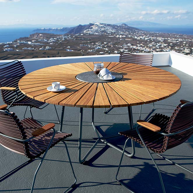 modern deck dining: four click dining armchairs staged with houe circle dining table