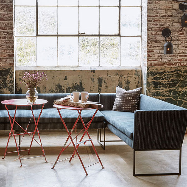 larkin 2-pc banquette in bengal pinstripe charcoal set up for café-style dining