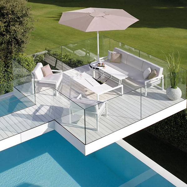 poolside paradise: 2 ninix lounge one seaters w/ bench module and palma umbrella
