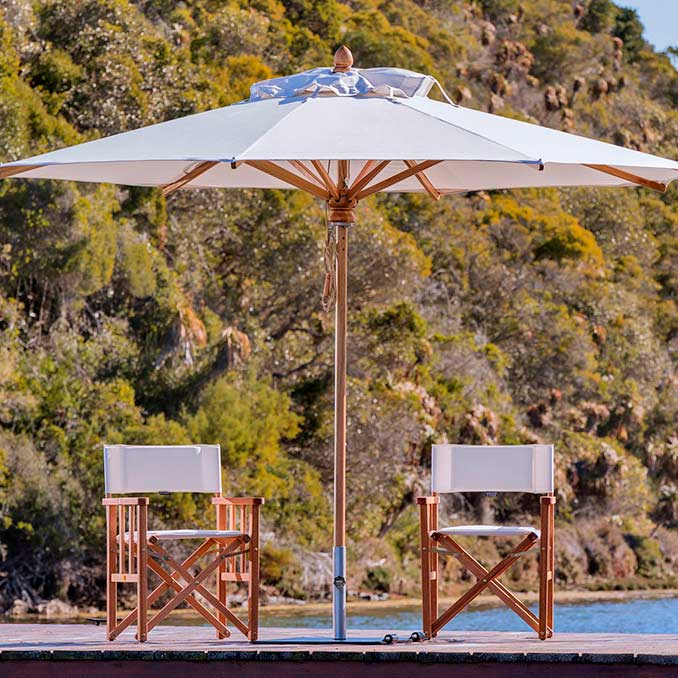 available in 6 sizes & 3 shapes: safari center pole umbrella with finest grade eucalyptus structure and weather resistant sunbrella canopy (base not included)