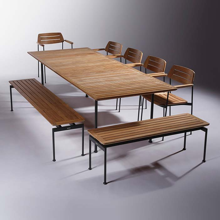"""fine use of space: barlow tyrie's layout 101"""" dining table with two 74"""" backless bench (lengthwise), 50"""" backless bench (widthwise) and five layout stacking armchairs"""