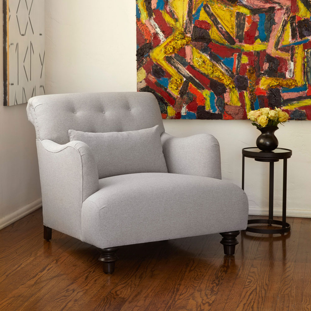 traditional shape of the acacia chair in naoki gray complementing modern art