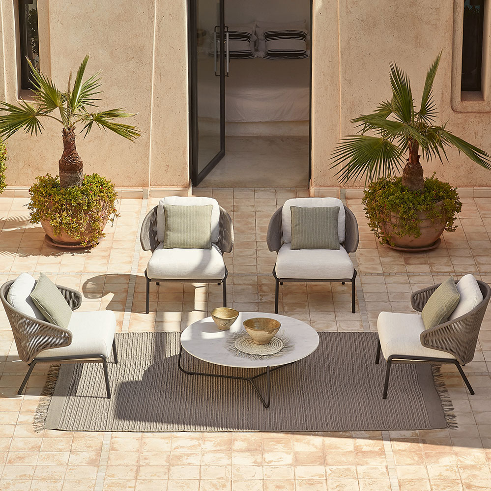 "private oasis: radius 1-seater chairs arranged around a marble white 39"" coffee table"