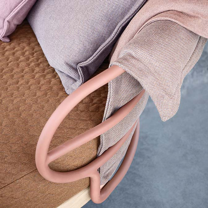 playing with color hues: two throw pillows in different sizes over two backrest blanketsimage provided courtesy of gloster furniture, inc.