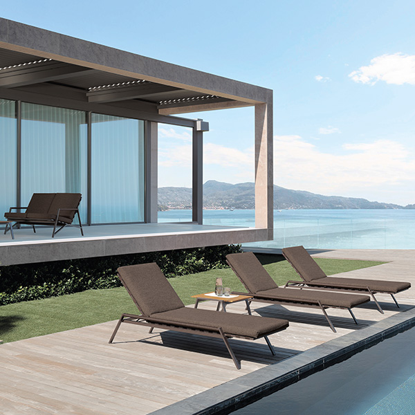 """first-row lounging: three cottage sunbeds with 23"""" square coffee table in the foreground   two cottage sofas with 47"""" square coffee table on the deck"""