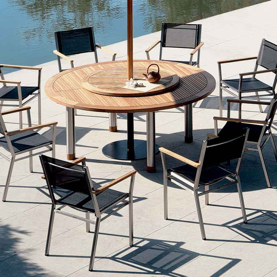 """impressive round-table: equinox 71"""" teak dining table with 40"""" lazy susan and eight of barlow tyrie's mercury armchairs in charcoal"""