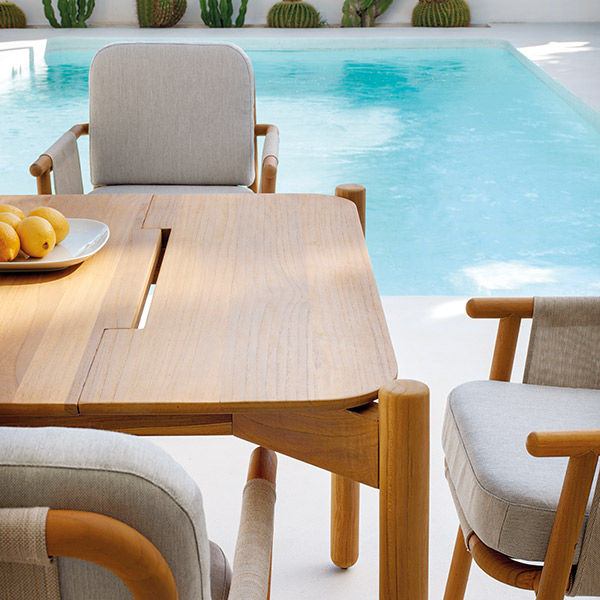 """rainproof: hamp 87"""" dining table with rain gouges and hamp dining armchairs with batyline seats and backs; plus, quick-dry cushions with sunbrella outdoor fabric"""