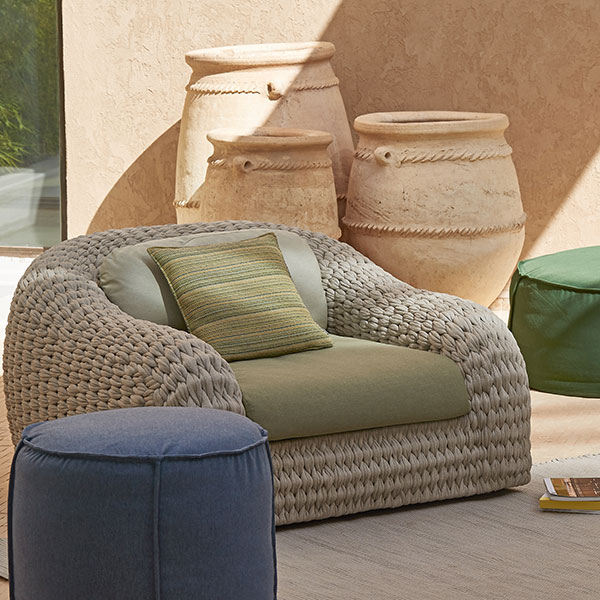 accent piece: kobo 1-seater surrounded by manutti's poufs available in many shapes, sizes and colors