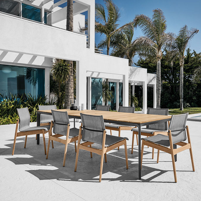 """eight sway side chairs (meteor/granite) with gloster carver 87"""" teak tableimage provided courtesy of gloster furniture, inc."""