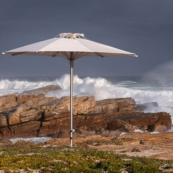 solid as a rock: 11.5' storm round center pole umbrella with sunbrella canopy in natural