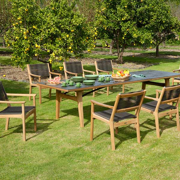 """monterey dining: eight armchairs around the 118"""" teak dining table with ceramic tabletop (oxide)"""
