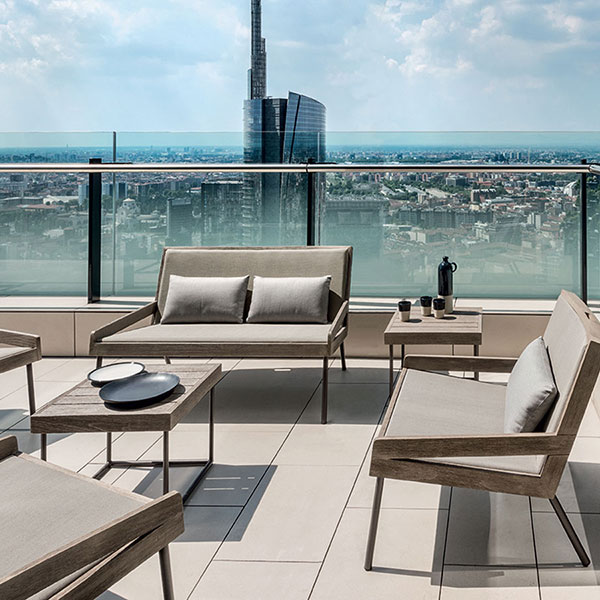 "three allaperto urban 2-seater sofas combined with allaperto urban lounge chair and the urban 20"" and 39"" coffee table"
