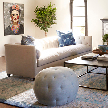 """complements any line: 20"""" pouf round ottoman with two of cisco brothers' kenso sofas"""