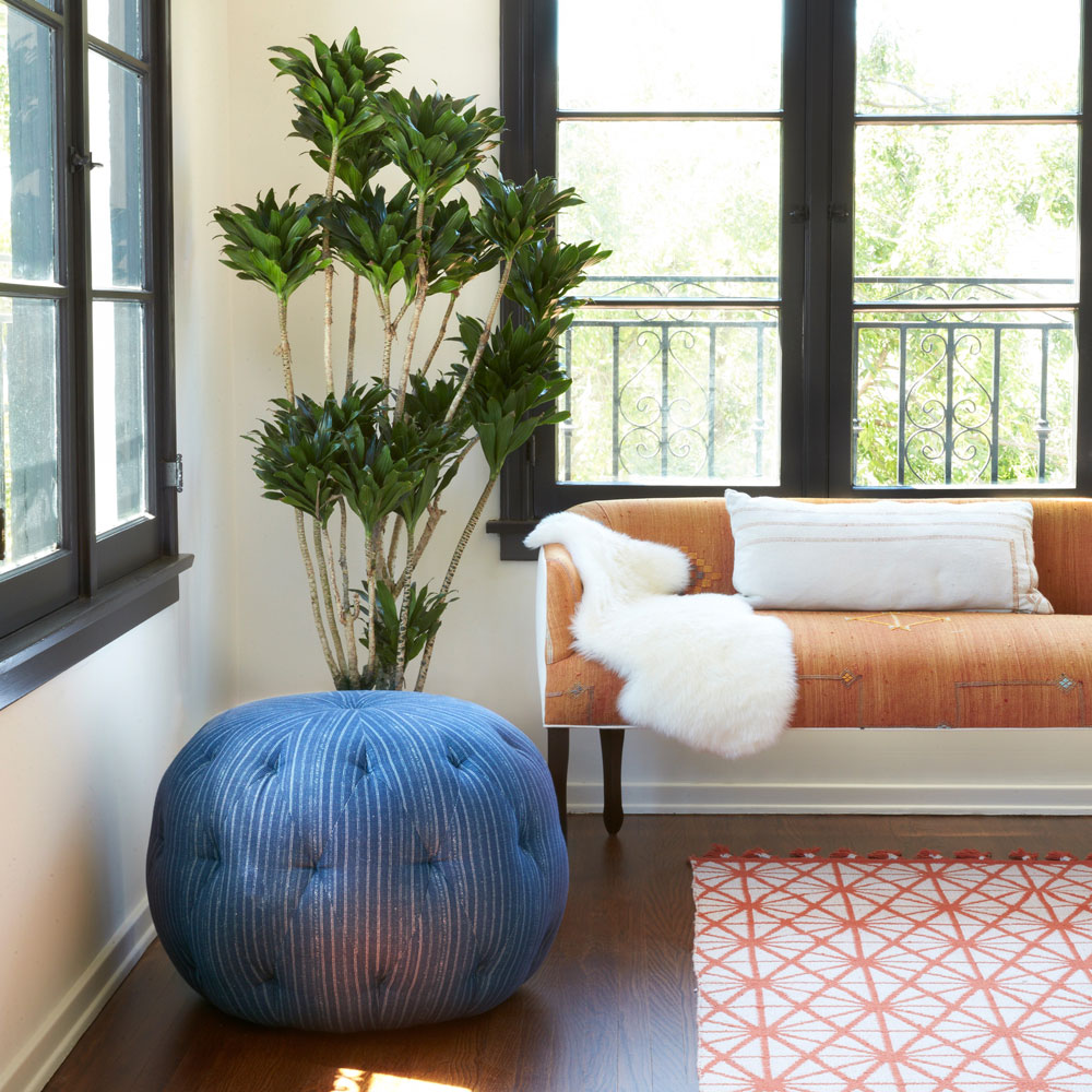 vocal point: elena settee in custom fabric (accessories not incl.) staged with cisco brothers' round pouf ottoman (left)