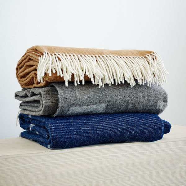 exuberant: there's never too many iota blankets (bottom to top: royal blue, light gray and cognac brown
