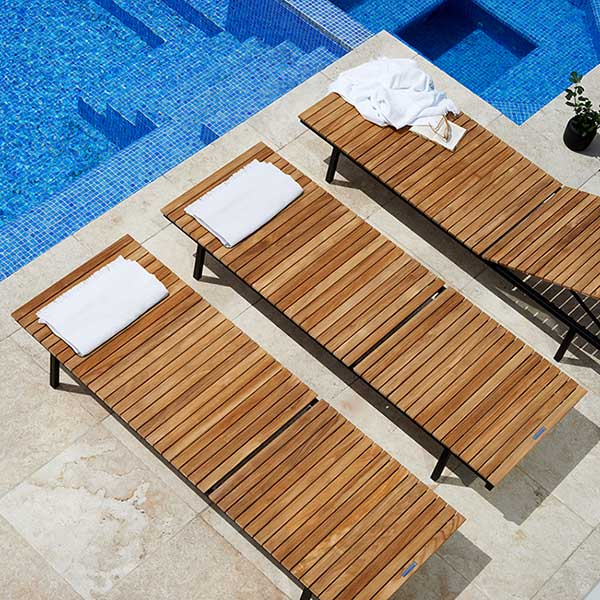 bathing in the sun: three haringe sun lounge chairs (all in black stainless steel; quick ship)