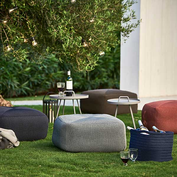 enjoy being outside: four cane-line's footstools
