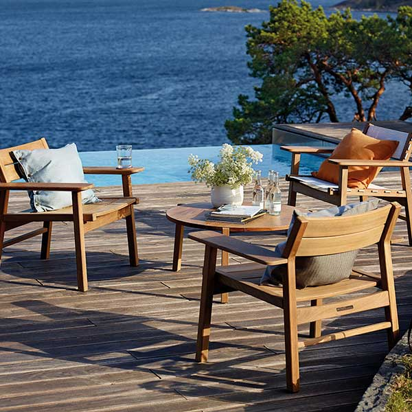 """mix and match: two djuro all-teak lounge armchairs, one teak-fabric lounge armchair and djuro 31"""" circular lounge table"""